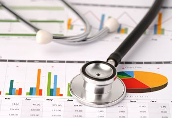 Stethoscope on chart or graph paper, Financial, account, statistics and business data  medical health concept.  Stethoscope on charts and graphs spreadsheet paper, Finance, Account, Statistics, Investment, Analytic research data economy and Business compa